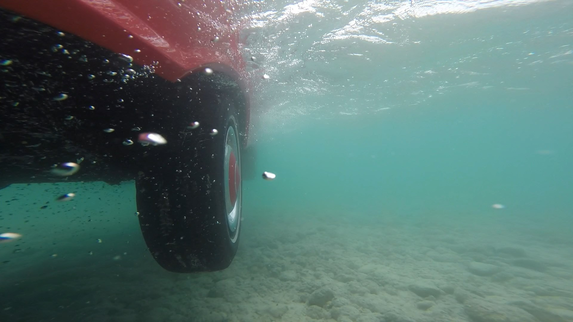 Under water shot as land drops away from Amphicar